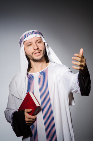 Arab man with book in diversity concept photo
