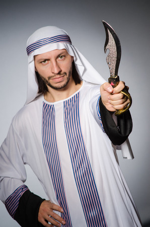 Arab man with sharp knife photo