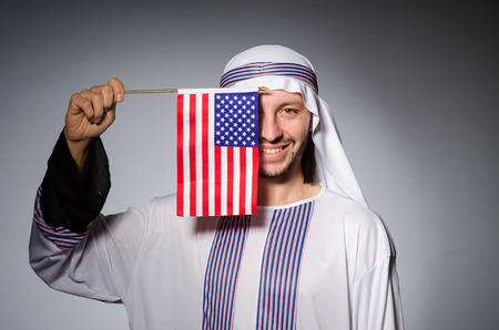 suriyah: Arab man with united states flag Stock Photo