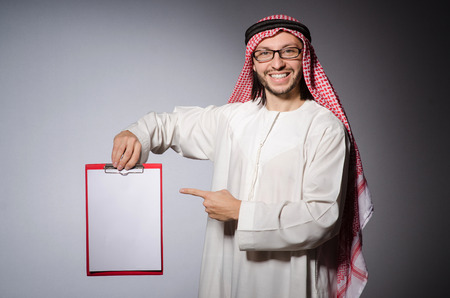 Arab man with paper binder photo