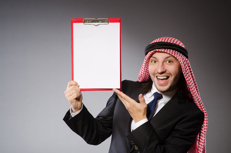 clothes organizer: Arab man with paper binder