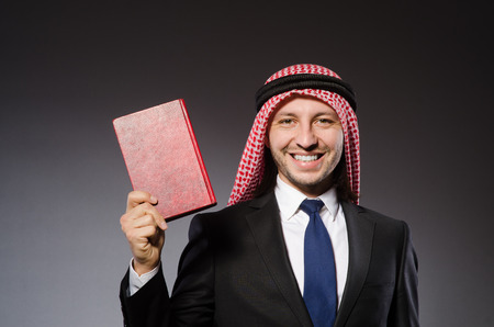 Arab man with book in diversity concept Stock Photo