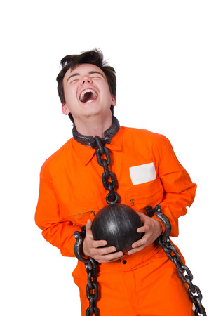 Young inmate with chains isolated on the white Stock Photo