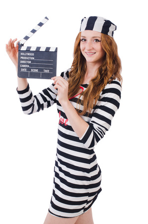 Young woman-prisoner with movie board isolated on white photo