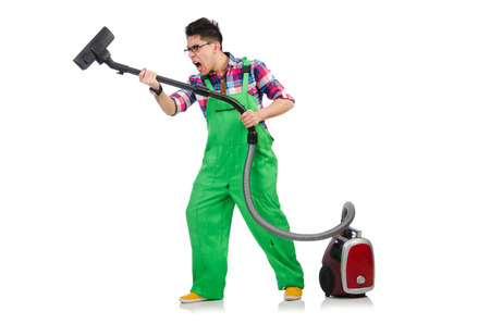 vacuum cleaning: Funny man in green coveralls vacuum cleaning