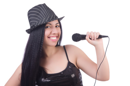 Young female singer with mic on white Stock Photo - 28920883