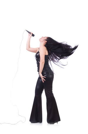 Young female singer with mic on white Stock Photo - 28920884