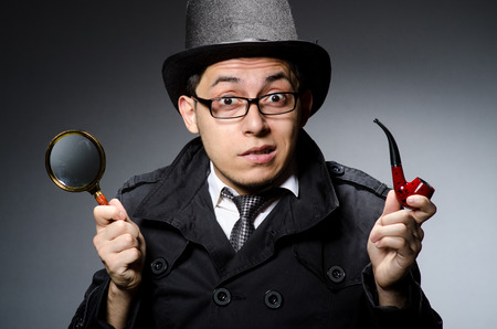 private detective: Funny detective with pipe and hat