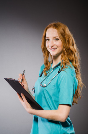 Woman doctor with paper notepad  photo