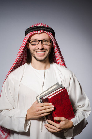 coran: Arab man with book in diversity concept Stock Photo