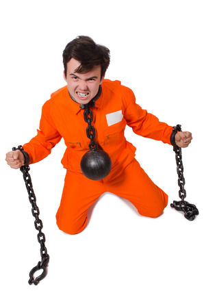 fetter: Young inmate with chains isolated on the white Stock Photo