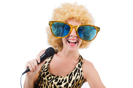 Funny singer   woman with mic and sunglasses  isolated on white Stock Photo - 28930869