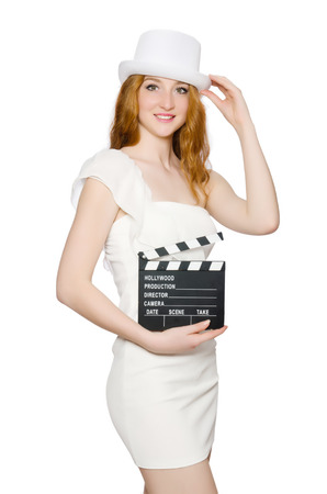 Young woman with movie board on white photo