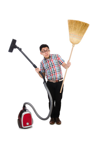Man with vacuum cleaner and broom on white photo