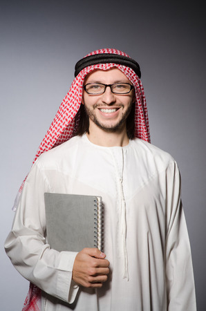 suriyah: Arab student with book in education concept