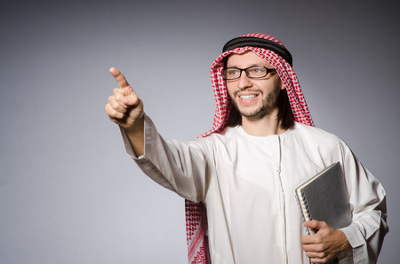 thoub: Arab man pressing virtual button
