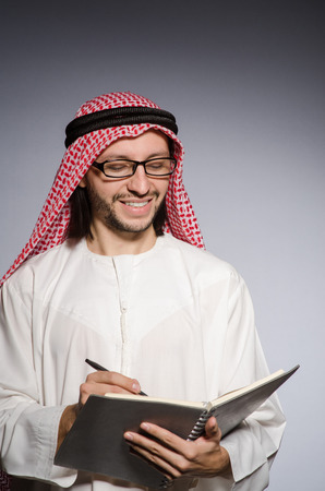 coran: Arab student with book in education concept