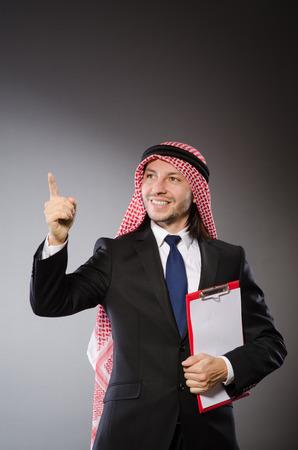 Arab man with paper binder photo