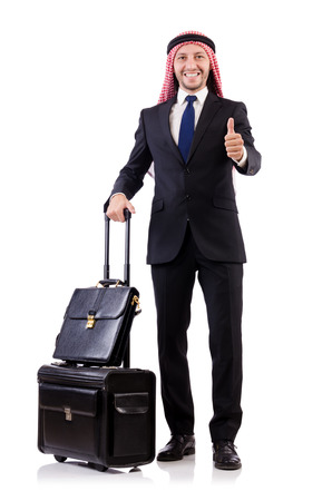 Arab man with luggage on white photo