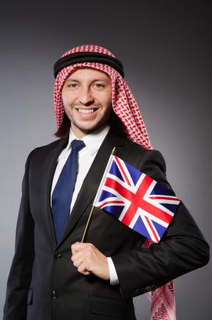 qameez: Arab man with united kingdom flag
