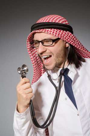 Funny arab doctor with stethoscope photo