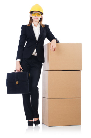 Young builder woman  with boxes  and bags  isolated on white photo