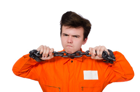 Young inmate with chains isolated on the white photo