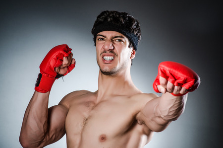 Muscular boxer wiith red gloves photo