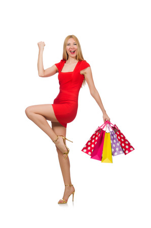 Young woman with shopping bags on white photo