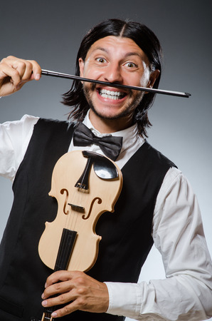Funny fiddle violin player in musical concept photo