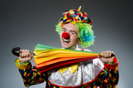 entertainers: Funny clown with colourful umbrella