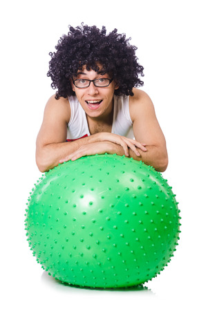 afrocut: Man with swiss ball doing exercises on white