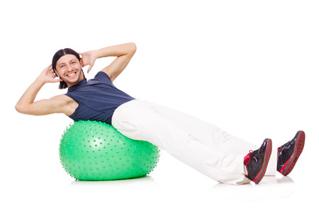 swiss ball: Man with swiss ball doing exercises on white