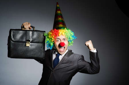 entertainers: Clown businessman in funny concept