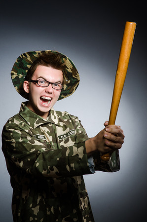 Funny soldier against the dark background photo