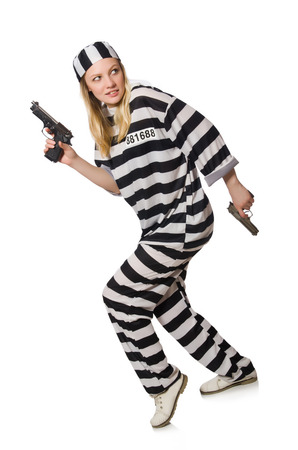Prison inmate with gun isolated on white photo