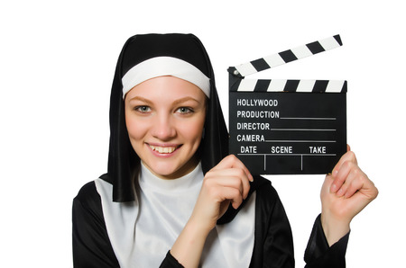Nun with movie board isolated on white photo