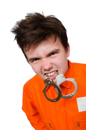 Funny prison inmate bite a handcuffs photo
