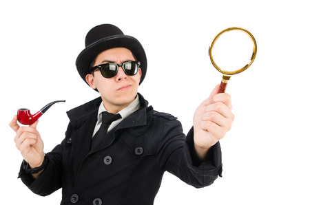 Young detective with pipe and magnifying glass photo