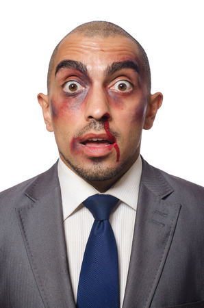 Badly beaten businessman isolated on white Stock Photo - 30334666