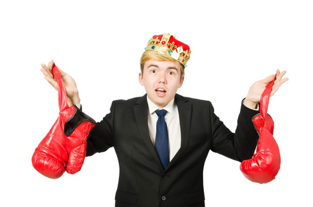 Funny businessman with crown and boxing gloves photo