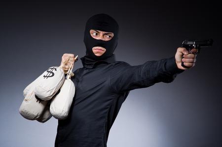 Man wearing balaclava with gun photo