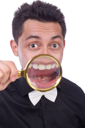 inquiring: Funny man with magnifying glass Stock Photo
