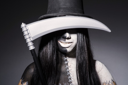 scythe: Woman in halloween concept with scythe Stock Photo