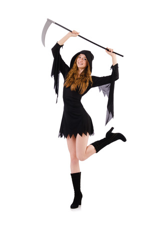 Young witch with scythe isolated on white photo