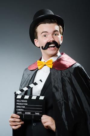 chaplin: Funny man with movie clapper board Stock Photo