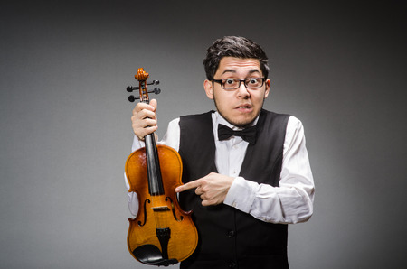fiddle: Funny violin player with fiddle Stock Photo