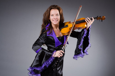 Woman artist with violin in music concept Stock Photo - 29996747
