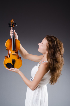 Woman artist with violin in music concept Stock Photo - 29996745