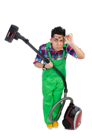 coveralls: Funny man in green coveralls vacuum cleaning